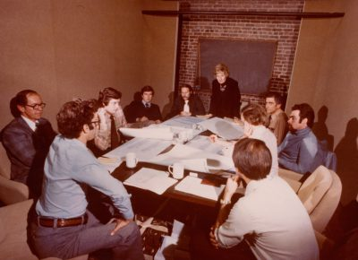 Beverly Willis & Associates in project meeting with Beverly Willis (standing), partner David Coldoff (opposite end) and project team, San Francisco, 1979. Beverly Willis Archive