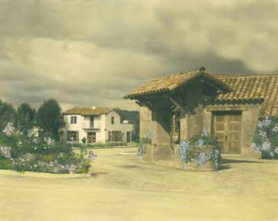 Lilian J. Rice, Garage Block, Paseo Delicias, Civic Center, Rancho Santa Fe, 1922–23. Hand-colored photograph. Courtesy of the Spurr Family
