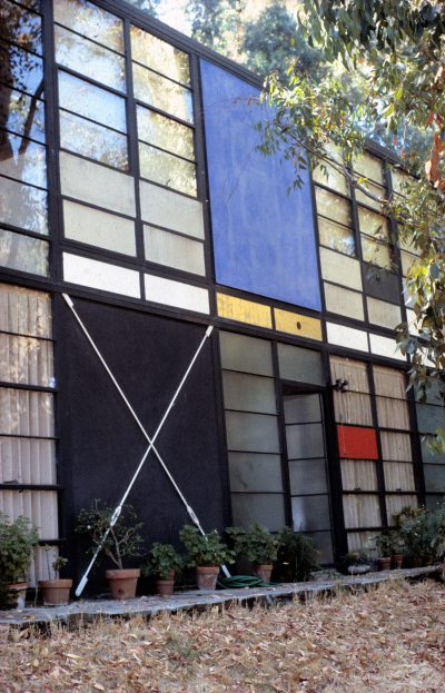 Charles Eames, Ray Eames, and Eero Saarinen, detail of Eames House showing front door open, Pacific Palisades, Calif., 1945–49. Photograph by Pat Kirkham, 1983 © Pat Kirkham