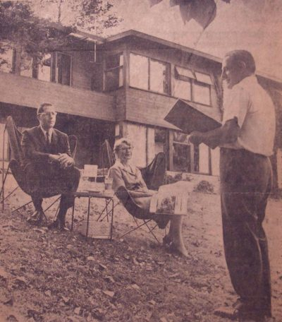 "Newspaper photo of the Clausses (with Alfred Clauss standing and Jane West Clauss and their son Peter sitting) in the backyard of the house they designed in 1948 in Wallingford, Penn. The photo by Sonnee Gottlieb appeared in an article, titled ""The Clausses Drew a Blueprint For a Happy, Working Marriage,"" in The Sunday Bulletin (Philadelphia), October 30, 1960. Courtesy of the Clauss family"